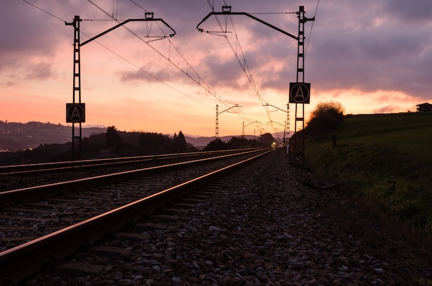 Railway station against beautiful sky at sunset. industrial landscape with railroad Premium Photo