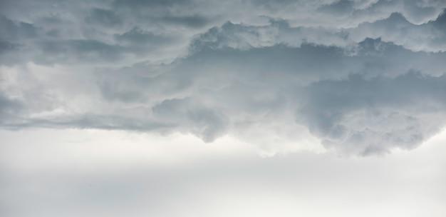 Rain clouds background.clouds become dark gray like a big smoke before rainfall Premium Photo