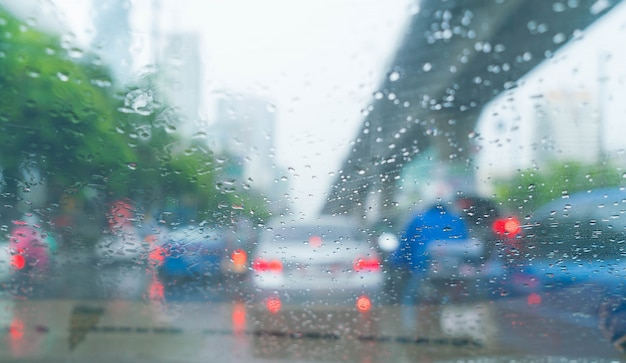 Rain drops on car glass Free Photo