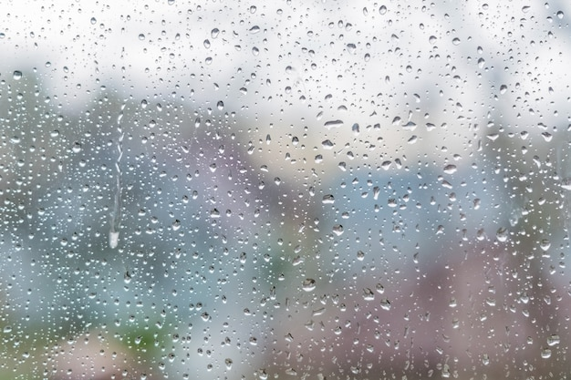 Rain drops on a window glass. abstract texture. Premium Photo