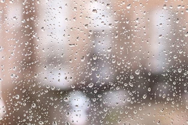 Rain drops on the window glass background Premium Photo