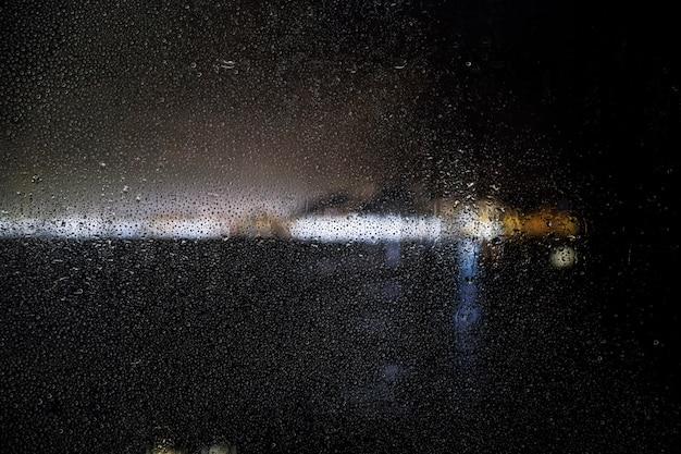 Rain effect on city night background Free Photo