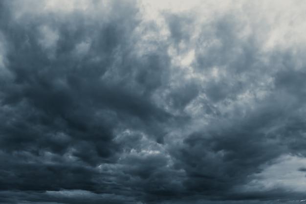 Rain storm cloudy darkness frightening sky in rainy season black dark color tone. Premium Photo