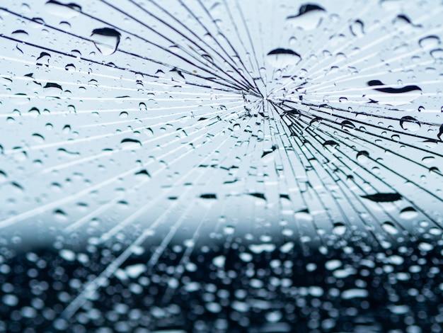 The rain water drop on the crack mirror Premium Photo