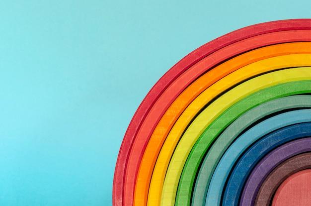 Rainbow colored wood. rainbow shape educational toy set Premium Photo