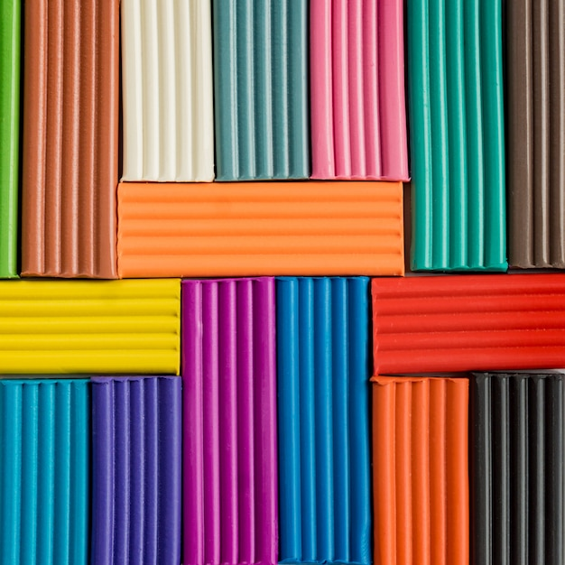 Rainbow colors of modeling clay. multicolored plasticine bars background. Premium Photo