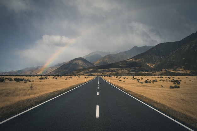 Rainbow above a country road Premium Photo