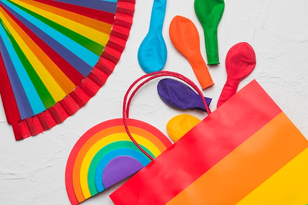 Rainbow lgbt fan and colorful decorative elements Free Photo