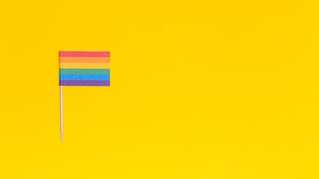 Rainbow lgbt flag on yellow background Free Photo
