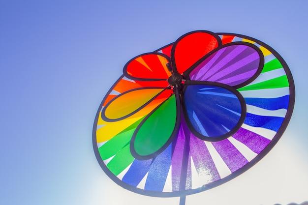 Rainbow lgbt pride spinning pinwheel. symbol of sexual minorities, gays and lesbians Premium Photo