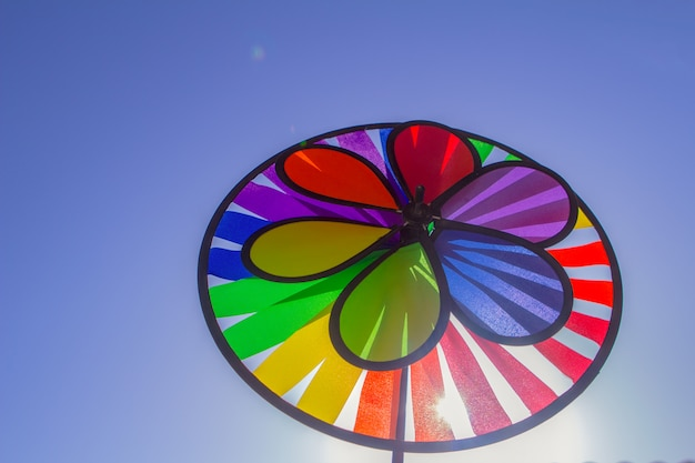 Rainbow lgbt pride spinning pinwheel. symbol of sexual minorities, gays and lesbians Premium Photo