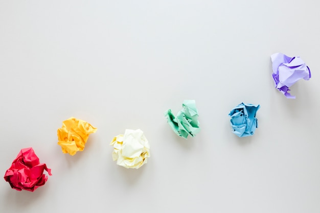 Rainbow made of colored crumpled paper balls Free Photo