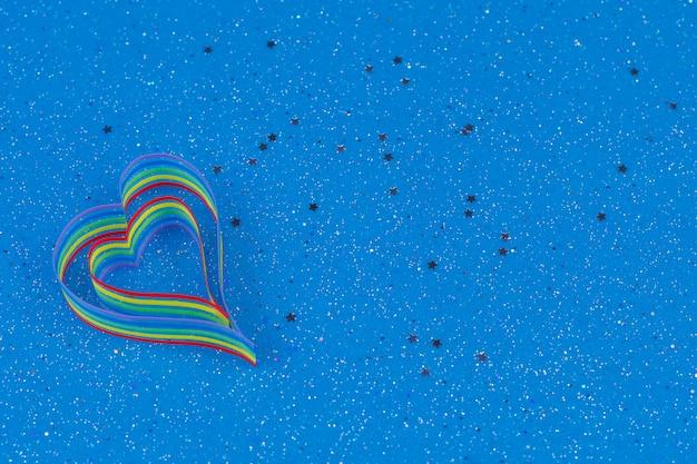 Rainbow ribbon awareness for lgbt community in shape of heart Premium Photo