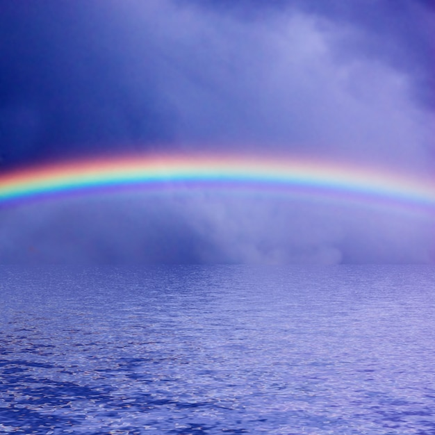 Rainbow over the sea Free Photo