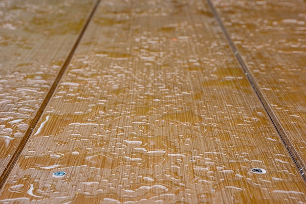 Raindrops on the plywood boards brown Premium Photo
