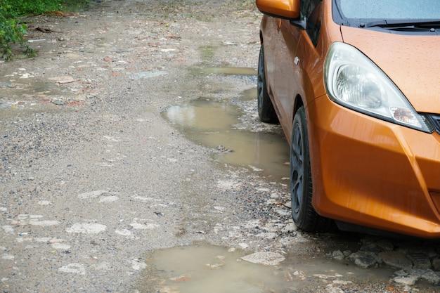 Rainwater trapped in a bumpy road Premium Photo