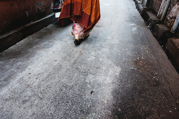 Rajasthani woman walking in the street Free Photo