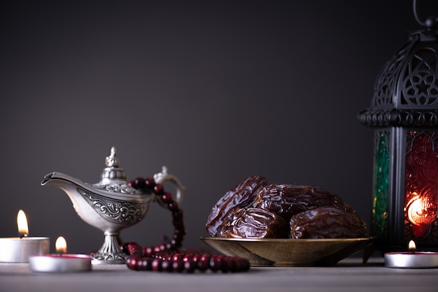 Ramadan food and drinks concept on a wooden table on dark copyspace Premium Photo