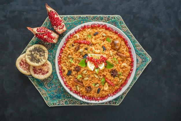 Ramadan food. vegetarian kabsa with rice, nuts and vegetables. Premium Photo
