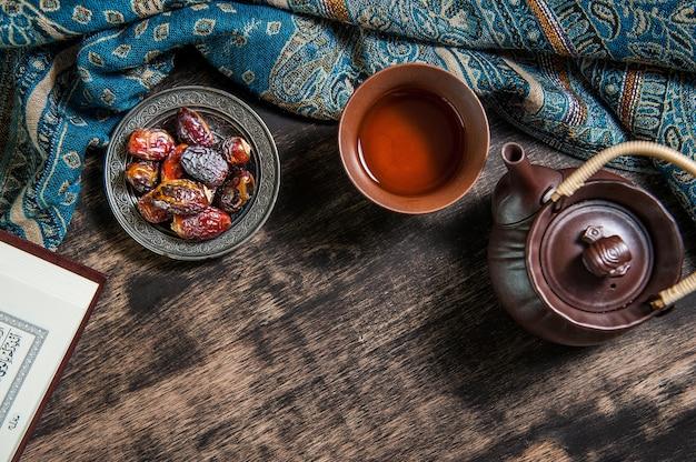 Ramadan of islam, date palm for ramadan and tea on a metal tray placed Premium Photo