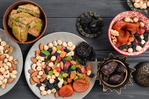Ramadan snack with traditional dried fruits; dates and baklava on table Free Photo