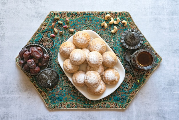 Ramadan sweets with tea and dates Premium Photo