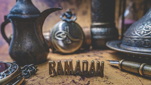 Ramadan with antique collection on old world map Premium Photo