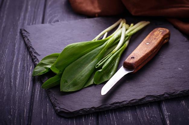 Ramson and knife on slate background Premium Photo