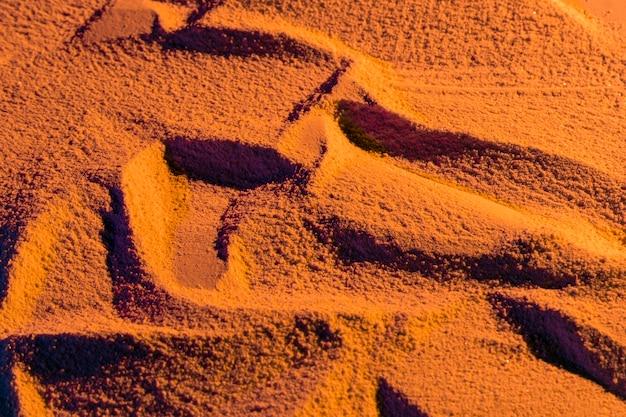 Randomly design of beach sand Free Photo