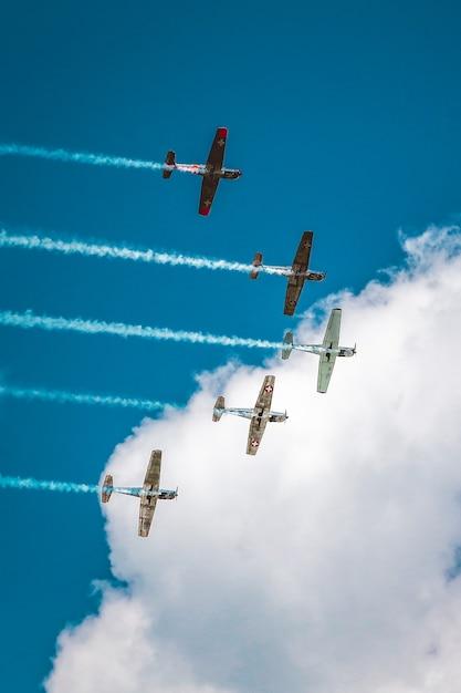 Range of aircraft preparing an air show under the breathtaking cloudy sky Free Photo