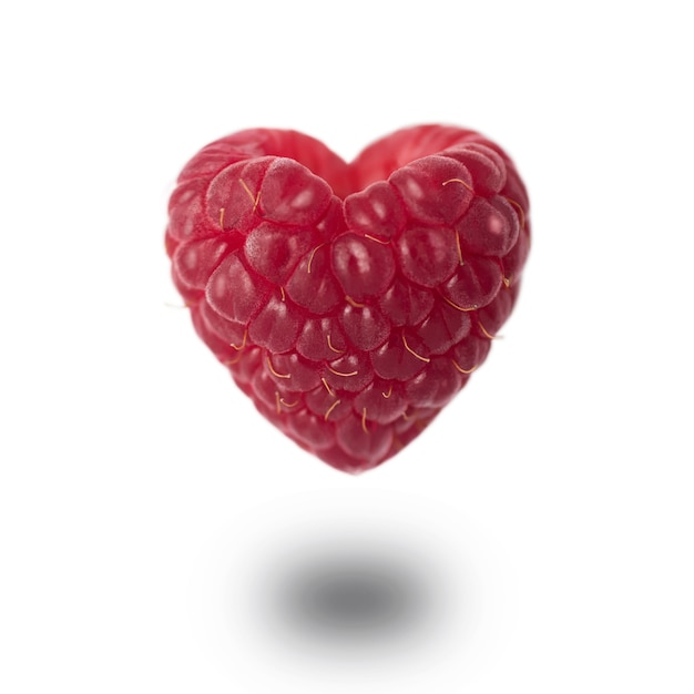 Raspberry in the shape of a heart Premium Photo