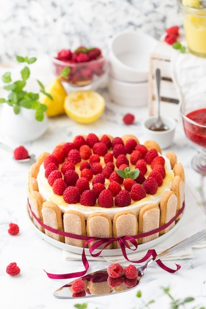 Raspberry tiramisu with lemon curd decorated red bow Premium Photo