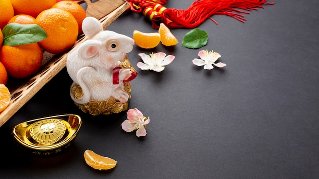 Rat figurine and cherry blossom chinese new year Free Photo