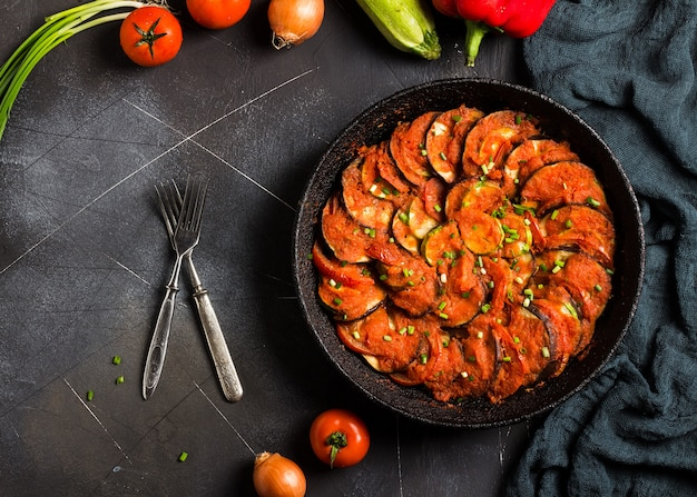 Ratatouille french provence dish of vegetables zucchini eggplant peppers and tomatoes Free Photo