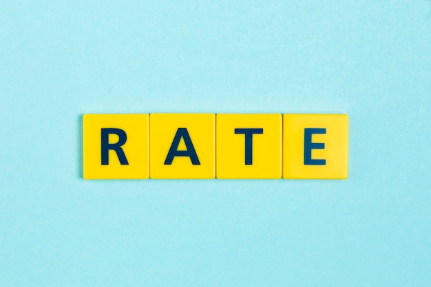 Rate word on scrabble tiles Free Photo