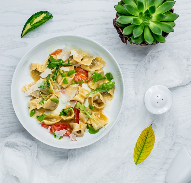 Ravioli with vegetables and cheese Free Photo
