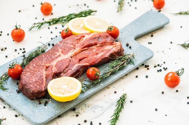 Raw beef meat on cutting board Free Photo