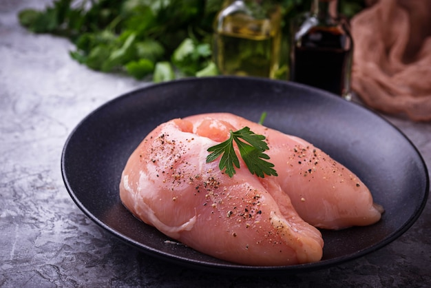 Raw chicken breasts or fillets Premium Photo