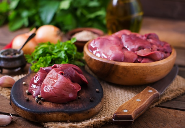 Raw chicken liver for cooking with onions and peppers Premium Photo