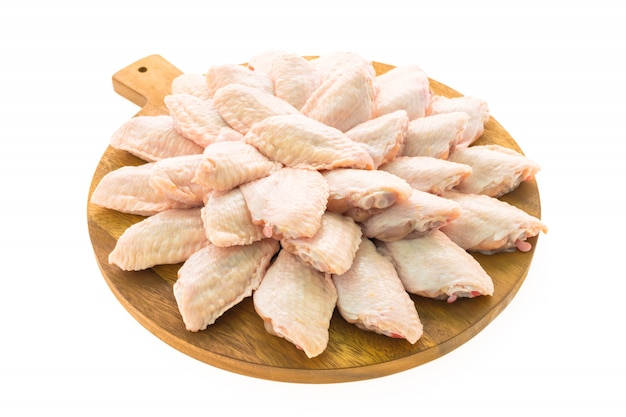 Raw chicken meat and wing on wooden cutting board or plate Free Photo