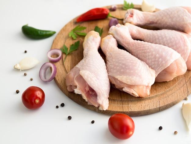 Raw chicken parts with different ingredients Premium Photo