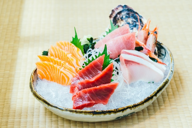 Raw and fresh salmon tuna and other sashimi fish meat Free Photo
