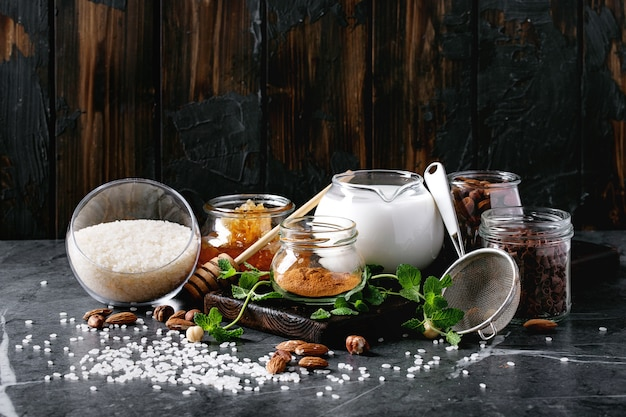 Raw ingredients for cooking rice pudding Premium Photo