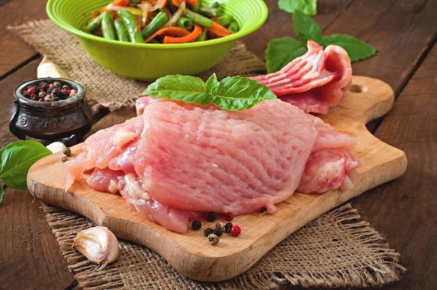 Raw ingredients for cooking stuffed vegetables chicken rolls Premium Photo