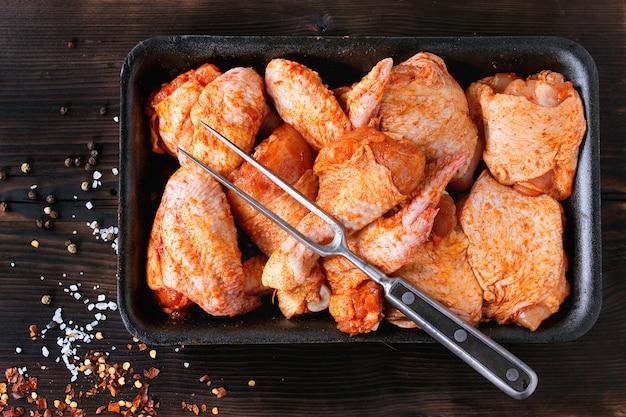 Raw marinated chicken for bbq Premium Photo