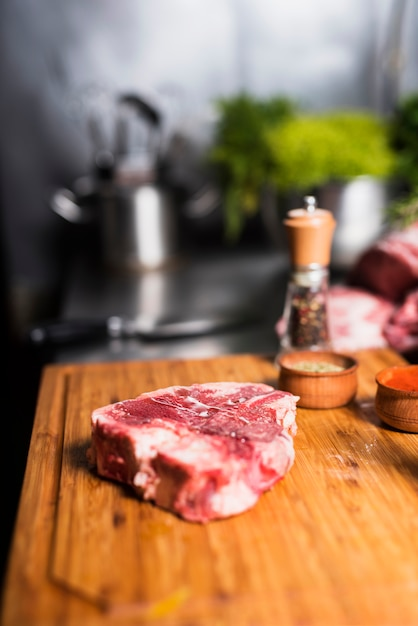 Raw meat steak with spices on board Free Photo