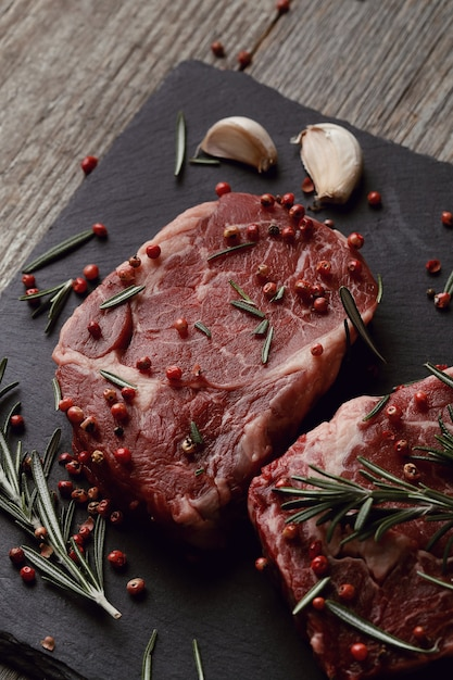 Raw meat with herbs and spices Free Photo