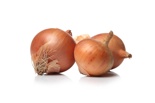 Raw onions on a white surface Free Photo