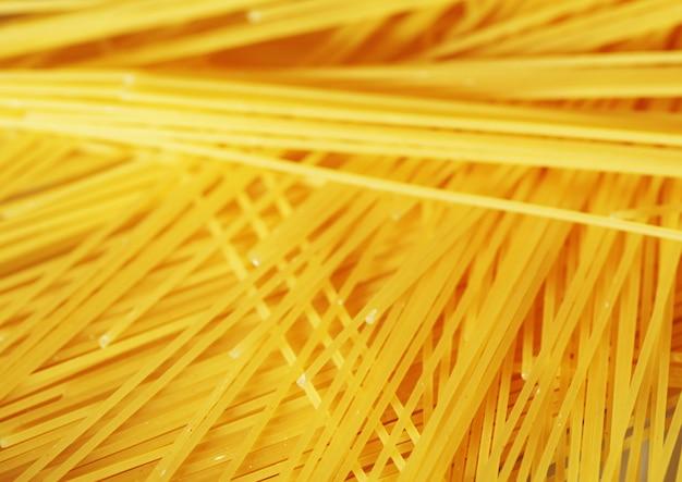 Raw pasta as whole background Premium Photo