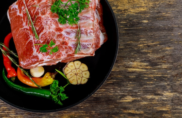 Raw pork meat on ribs and herb. Premium Photo